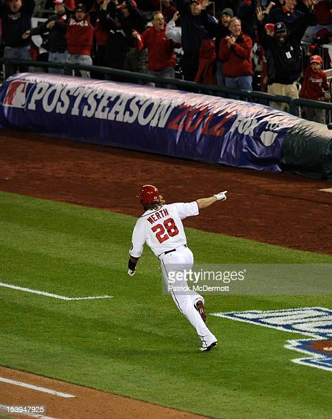 Jayson Werth of the Washington Nationals celebrates as he run to first base on his solo gamewinning walkoff home run in the bottom of the ninth...