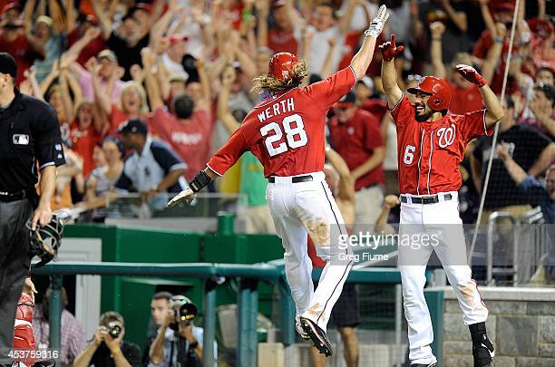 Jayson Werth of the Washington Nationals celebrates with Anthony Rendon after scoring the game winning run in the 11th inning against the Pittsburgh...