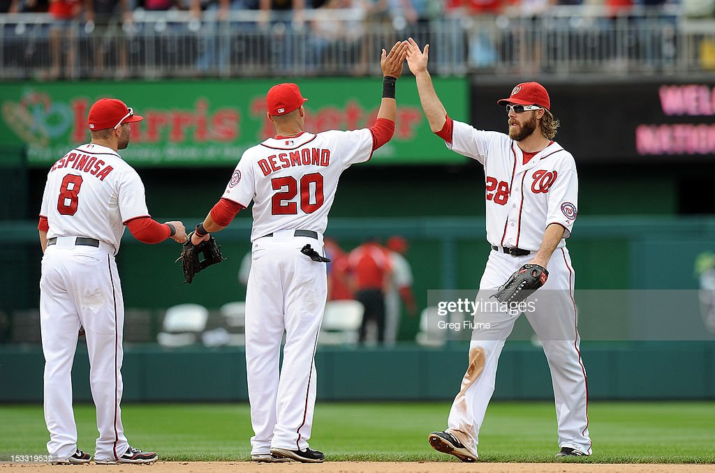 Jayson Werth #28 of the Washington Nationals celebrates with Danny Espinosa #8 and Ian Desmond #20 after a 5-1 victory against the Philadelphia Phillies at Nationals Park on October 3, 2012 in Washington, DC.