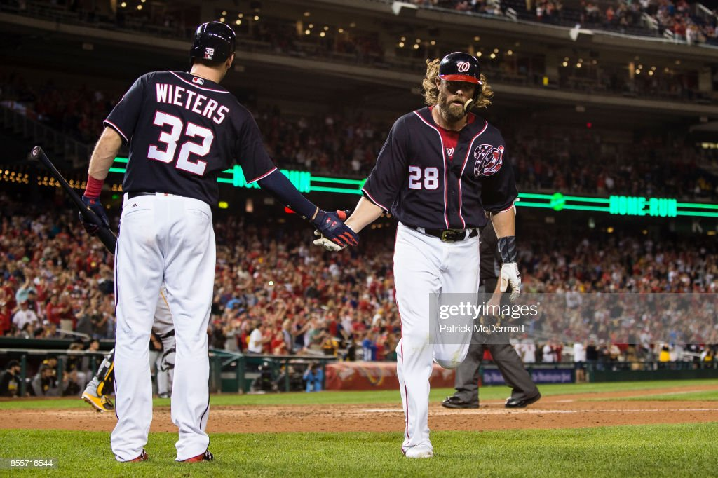 Jayson Werth #28 of the Washington Nationals celebrates with Matt Wieters #32 after hitting a solo home run in the eighth inning against the Pittsburgh Pirates at Nationals Park on September 29, 2017 in Washington, DC.
