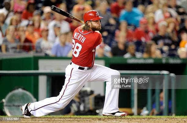 Jayson Werth of the Washington Nationals drives in the game winning run with a double in the eighth inning against the New York Mets at Nationals...