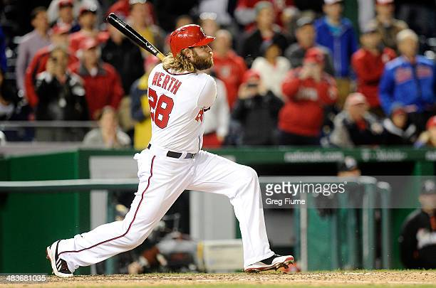 Jayson Werth of the Washington Nationals hits a grand slam in the eighth inning against the Miami Marlins at Nationals Park on April 9 2014 in...
