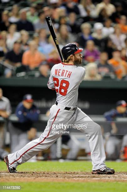 Jayson Werth of the Washington Nationals hits a home run in the seventh inning against the Baltimore Orioles at Oriole Park at Camden Yards on May 20...