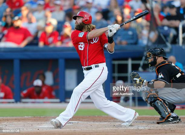 Jayson Werth of the Washington Nationals hits a tworun home run against the Miami Marlins in the second inning during a spring training game at The...