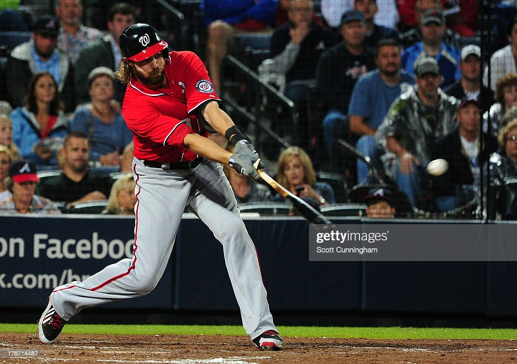 Jayson Werth #28 of the Washington Nationals hits a two-run single in the second inning against the Atlanta Braves at Turner Field on August 17, 2013 in Atlanta, Georgia.