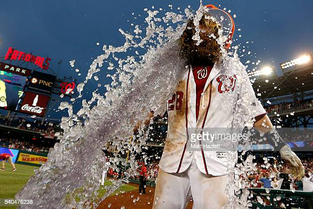 Jayson Werth of the Washington Nationals is doused with a bucket of Gatorade by teammate Wilson Ramos after hitting a walkoff single RBI in the...