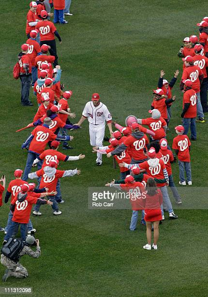 Jayson Werth of the Washington Nationals is greeted after being introduced before the start of opening day against the Atlanta Braves at Nationals...