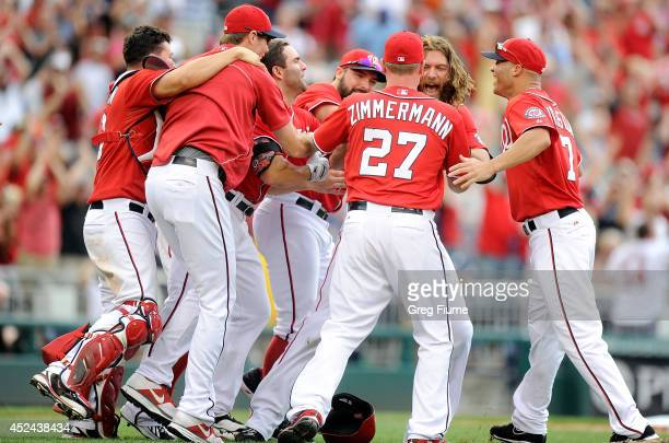 Jayson Werth of the Washington Nationals is mobbed by teammates after driving in the game winning run in the ninth inning against the Milwaukee...