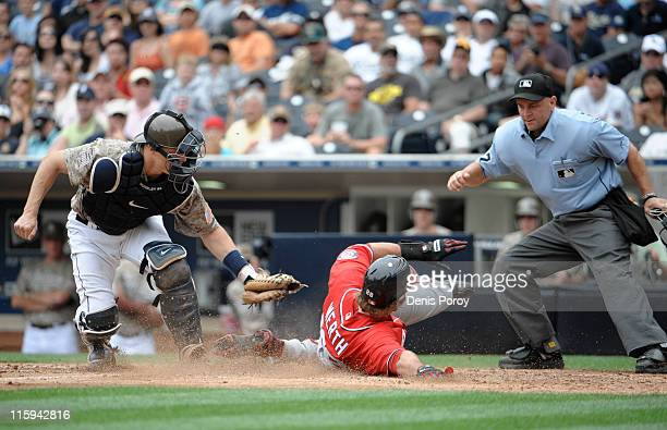 Jayson Werth of the Washington Nationals is tagged out at the plate by Nick Hundley of the San Diego Padres as umpire Scott Barry makes the call...