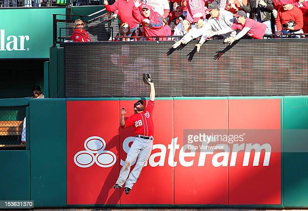 Jayson Werth of the Washington Nationals makes a catch at the wall to save a home run in the sixth inning against the St Louis Cardinals during Game...