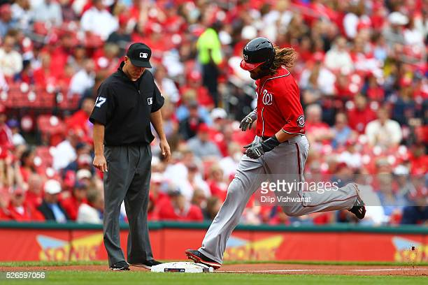Jayson Werth of the Washington Nationals rounds third base after hitting a threerun home run against the St Louis Cardinals in the first inning at...