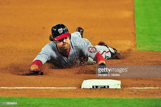 Jayson Werth of the Washington Nationals slides into third base during a MLB game against the Florida Marlins at Sun Life Stadium on April 7 2011 in...