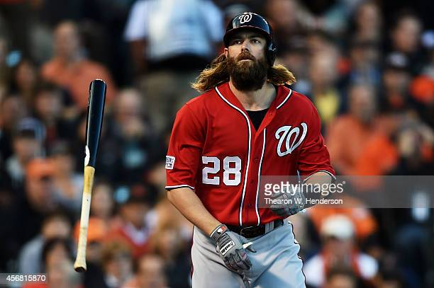 Jayson Werth of the Washington Nationals tosses his bat after being walked in the first inning against the San Francisco Giants during Game Four of...