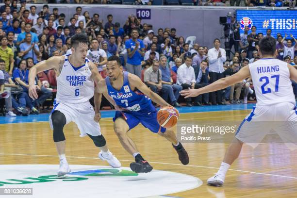 Jayson William driving to the basket against YiHsiang Chou Gilas Pilipinas defended their home against Chinese Taipei Game ended at 90 83