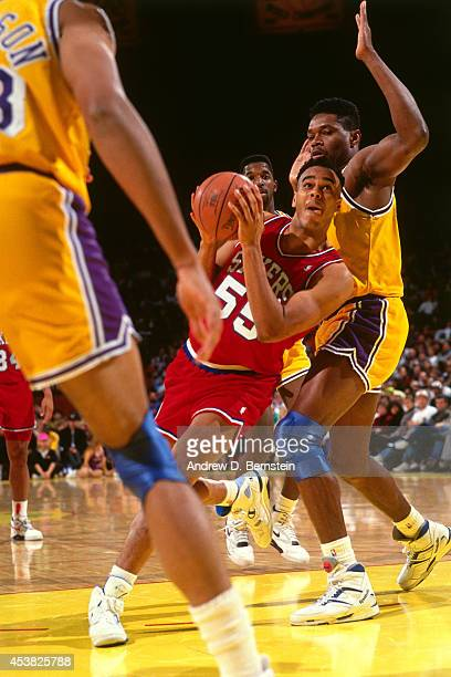 Jayson Williams of the Philadelphia 76ers drives against the Los Angeles Lakers circa 1991 at the Great Western Forum in Inglewood California NOTE TO...