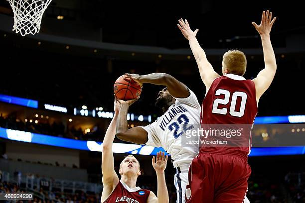 JayVaughn Pinkston of the Villanova Wildcats shoots the ball against Seth Hinrichs and Dan Trist of the Lafayette Leopards in the first half during...