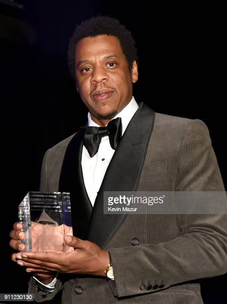 JayZ accepts award onstage during the Clive Davis and Recording Academy PreGRAMMY Gala and GRAMMY Salute to Industry Icons Honoring JayZ on January...