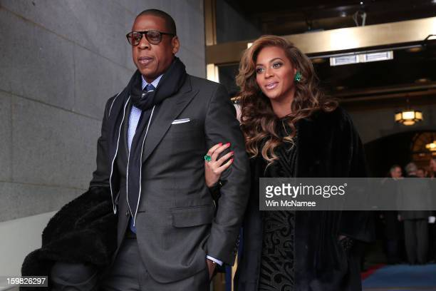 JayZ and Beyonce arrive at the presidential inauguration on the West Front of the US Capitol January 21 2013 in Washington DC Barack Obama was...