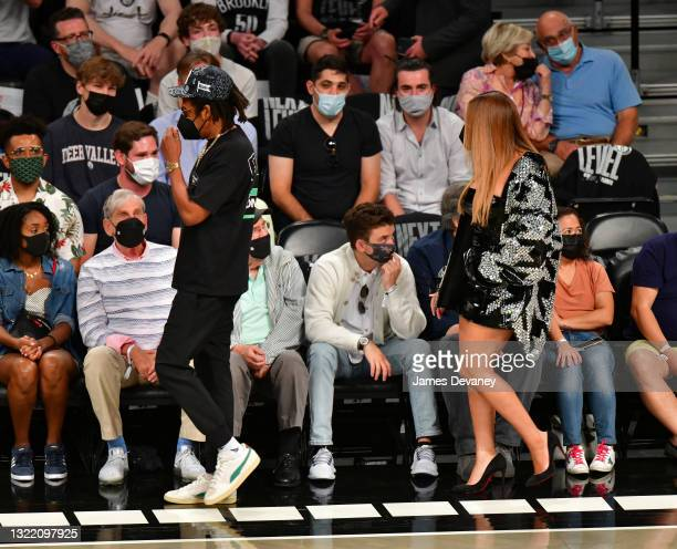 Jay-Z and Beyonce attend Brooklyn Nets v Milwaukee Bucks game at Barclays Center of Brooklyn on June 05, 2021 in New York City.