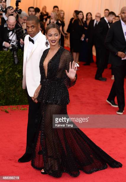 JayZ and Beyonce attend the 'Charles James Beyond Fashion' Costume Institute Gala held at the Metropolitan Museum of Art on May 5 2014 in New York...