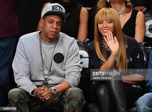 JayZ and Beyonce Knowles attend the New York Knicks v Brooklyn Nets game at Barclays Center on November 26 2012 in the Brooklyn borough of New York...