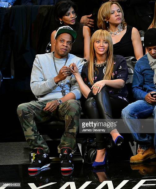 JayZ and Beyonce Knowles attend the New York Knicks vs Brooklyn Nets game at Barclays Center on November 26 2012 in the Brooklyn borough of New York...