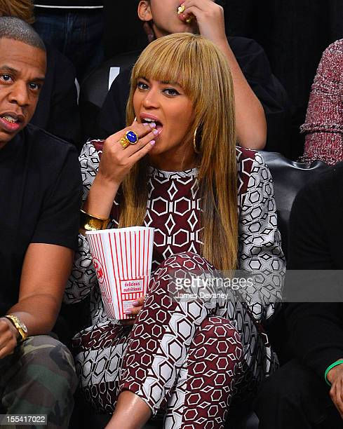 JayZ and Beyonce Knowles attend Toronto Raptors vs Brooklyn Nets at Barclays Center on November 3 2012 in Brooklyn New York