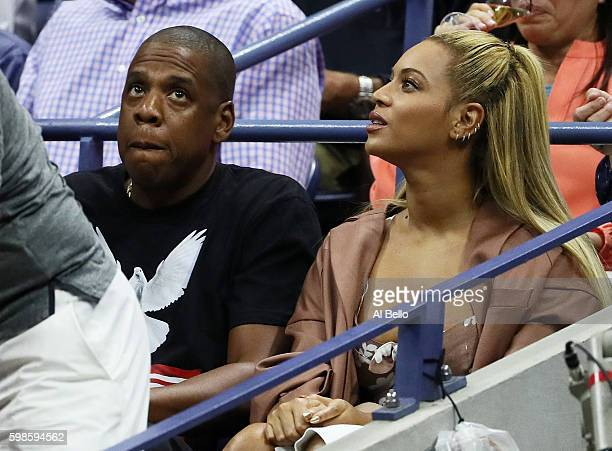 JayZ and Beyonce watch the second round Women's Singles match between Serena Williams of the United States and Vania King of the United States on Day...