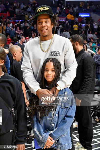 Jay-Z and Blue Ivy Carter attend a basketball game between the Los Angeles Clippers and the Los Angeles Lakers at Staples Center on March 08, 2020 in...