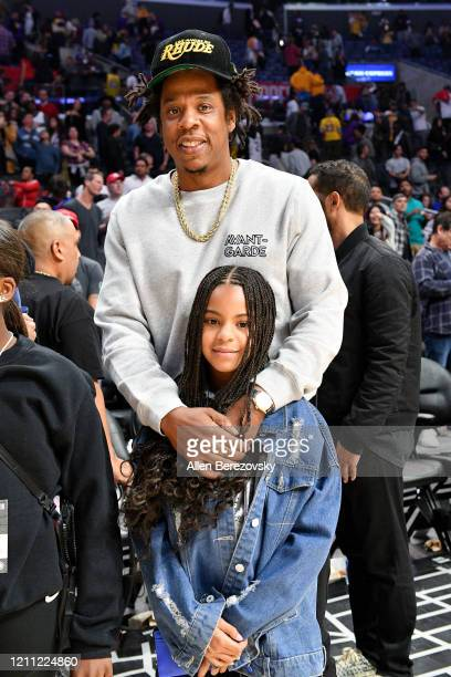JayZ and Blue Ivy Carter attend a basketball game between the Los Angeles Clippers and the Los Angeles Lakers at Staples Center on March 08 2020 in...