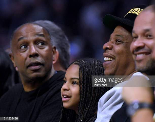 Jay-Z and Blue Ivy Carter smile during the game between the Los Angeles Lakers and the LA Clippers at Staples Center on March 08, 2020 in Los...