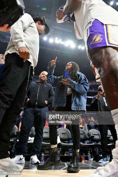 Jay-Z and Blue Ivy Carter talk with LeBron James after a basketball game between the Los Angeles Clippers and the Los Angeles Lakers at Staples...