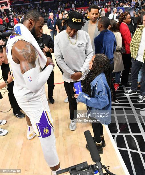 JayZ and Blue Ivy Carter talk with LeBron James after a basketball game between the Los Angeles Clippers and the Los Angeles Lakers at Staples Center...