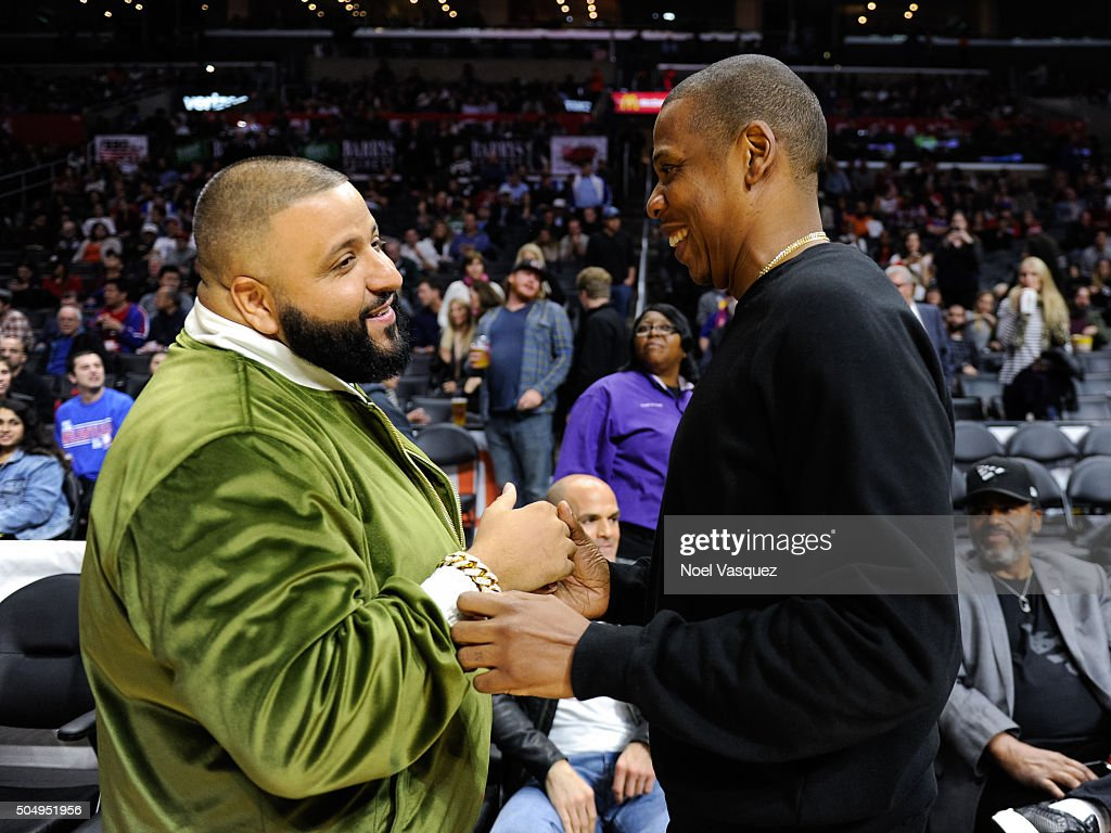 Jay-Z (L) and DJ Khaled attend a basketball game between the Miami Heat and the Los Angeles Clippers at Staples Center on January 13, 2016 in Los Angeles, California.