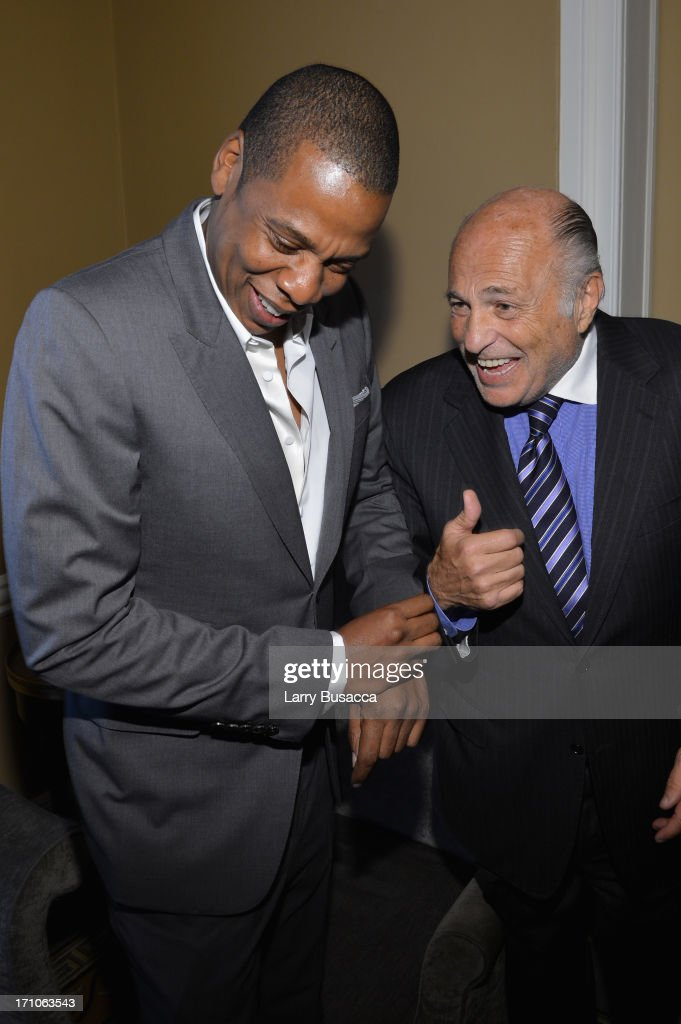 Jay-Z and Doug Morris attend a luncheon honoring Rob Stringer as UJA-Federation of New York Music Visionary of 2013 at The Pierre Hotel on June 21, 2013 in New York City.