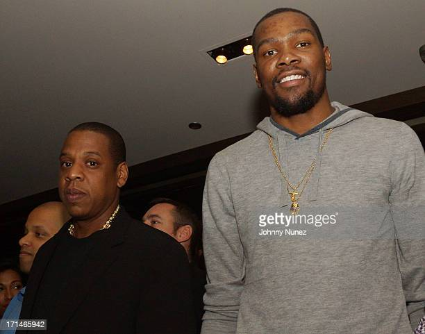 JayZ and Kevin Durant attend The 'Super Heroes' Fundraiser And Domino Tournament at The 40/40 Club on June 24 2013 in New York City