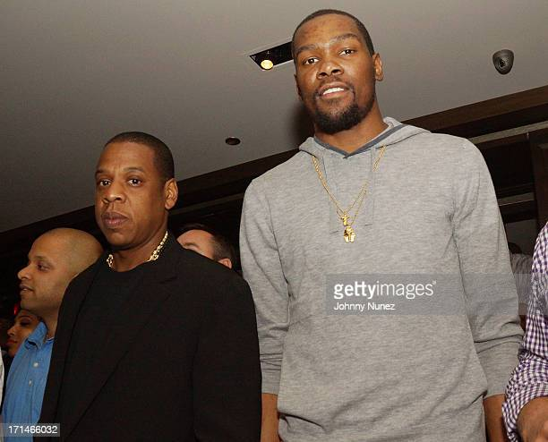 JayZ and Kevin Durant attend The Super Heroes Fundraiser And Domino Tournament at The 40/40 Club on June 24 2013 in New York City
