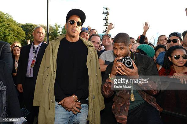 JayZ and Usher watch from the crowd during 2015 Global Citizen Festival to end extreme poverty by 2030 in Central Park on September 26 2015 in New...