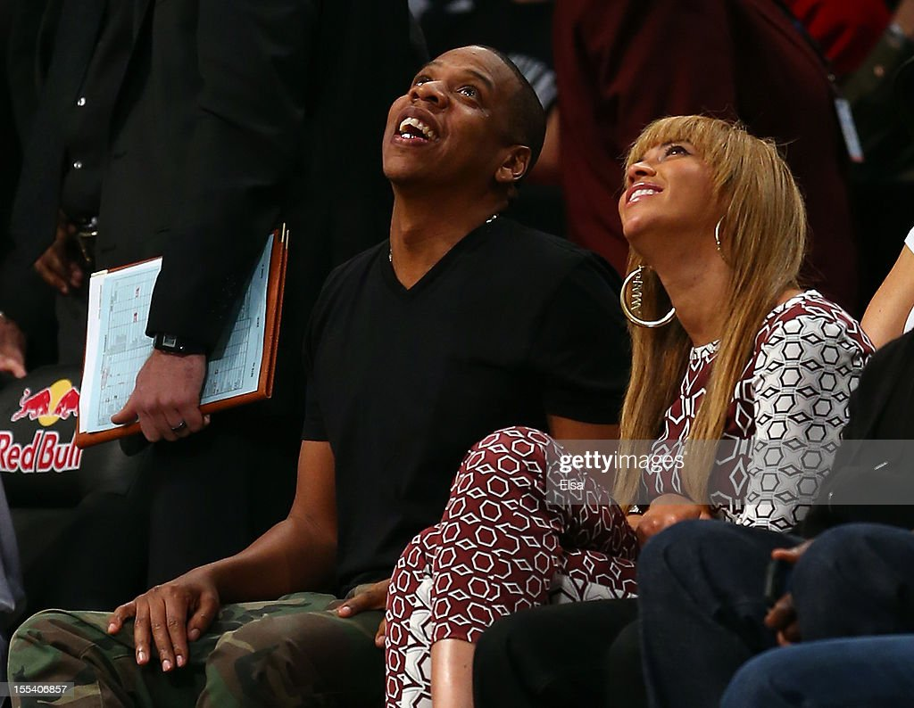 Jay-Z and wife Beyonce atttend the game between the Brooklyn Nets and the Toronto Raptors at the Barclays Center on November 3, 2012 in the Brooklyn borough of New York City.