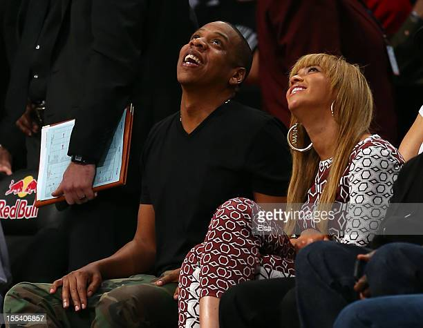JayZ and wife Beyonce atttend the game between the Brooklyn Nets and the Toronto Raptors at the Barclays Center on November 3 2012 in the Brooklyn...