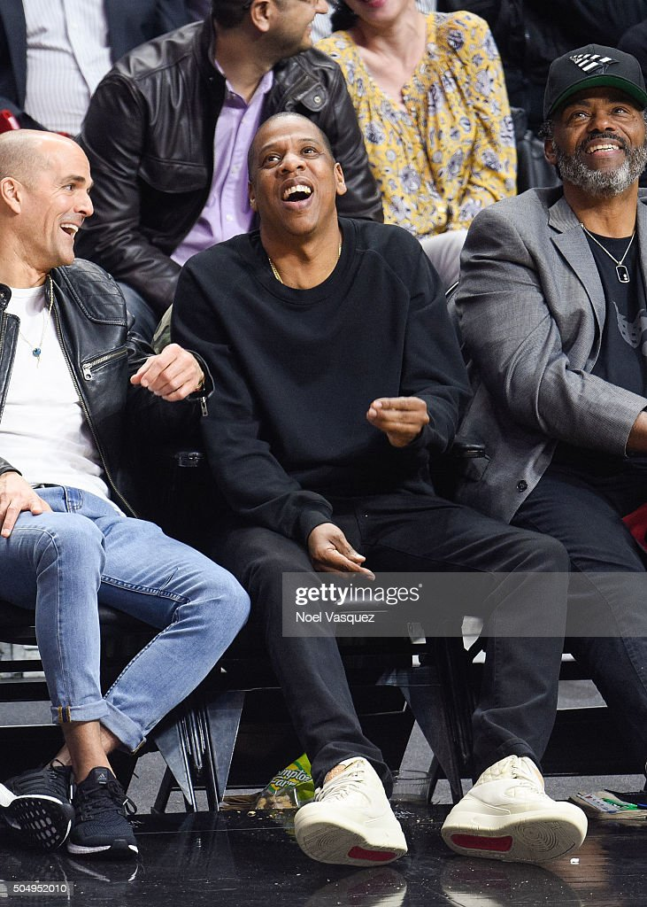 Jay-Z (R) attends a basketball game between the Miami Heat and the Los Angeles Clippers at Staples Center on January 13, 2016 in Los Angeles, California.