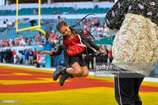 Jay-Z photographs his daughter Blue Ivy Carter as she jumps in the end zone before the start of Super Bowl LIV at Hard Rock Stadium in Miami Gardens,...