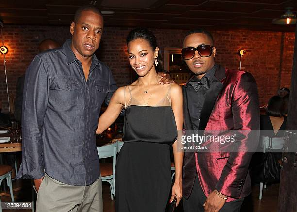 Jay-Z, Zoe Saldana and Nas attend Nas' 38th birthday party at Catch on September 14, 2011 in New York City.