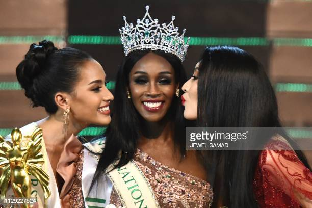 Jazell Barbie Royale of the US the Miss International Queen 2019 receives a kiss from finalists Kanwara Kaewjin of Thailand and Yaya of China during...