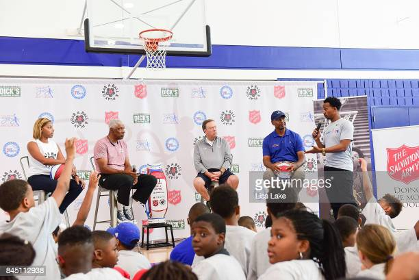 Jazmin and Julius Erving Tom Shirley Charles Turner and Christian Crosby speak to children during the Erving Youth Basketball Clinic on September 9...