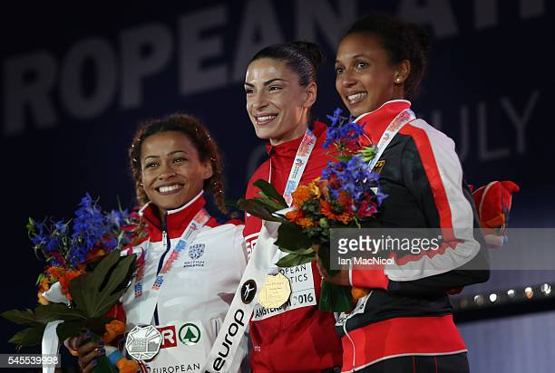 Jazmin Sawyers of Great Britain Ivana Spanovic of Serbia and Malaika Mihambo of Germany pose for a picture with their medals from the womens long...