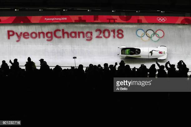 Jazmine FenlatorVictorian and Carrie Russell of Jamaica slide during the Women's Bobsleigh heats at the Olympic Sliding Centre on day eleven of the...