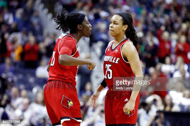 Jazmine Jones and Asia Durr of the Louisville Cardinals celebrate the play against the Mississippi State Lady Bulldogs during the second half in the...