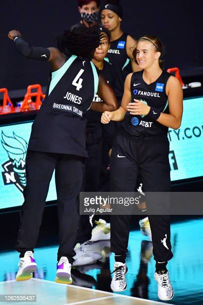 Jazmine Jones and Sabrina Ionescu of the New York Liberty jump during introductions before a game against the Dallas Wings at Feld Entertainment...