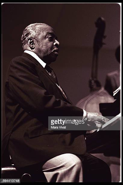 Jazz band leader and pianist Count Basie plays the piano